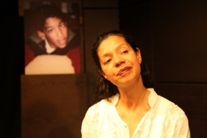 Jaye Griffiths on stage, with a photo of Nihal Armstrong
